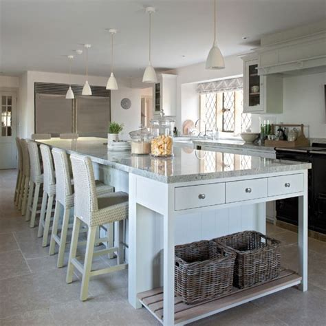 15 kitchen islands with seating for your family home family kitchen with long island family kitchen design