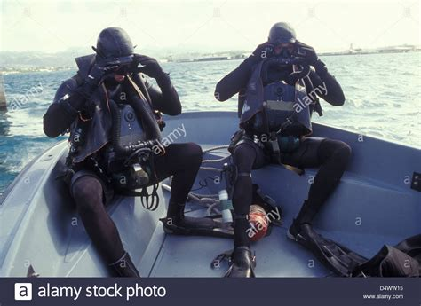 navy seals dive navy seals combat swimmers in a utility boat adjust their