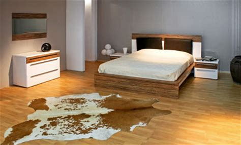 cowhide rug bedroom the cowhide rug makes a comeback cowhide rugs reindeer hides city cows blog