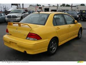 2002 mitsubishi lancer oz rally in lightning yellow photo