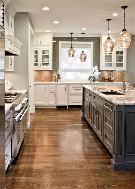 gray island  white cabinets granite top white oak