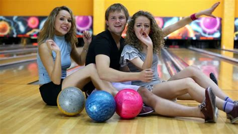 soap two girls and one boy two stand boy and they with bowling balls in club stock footage 2134934