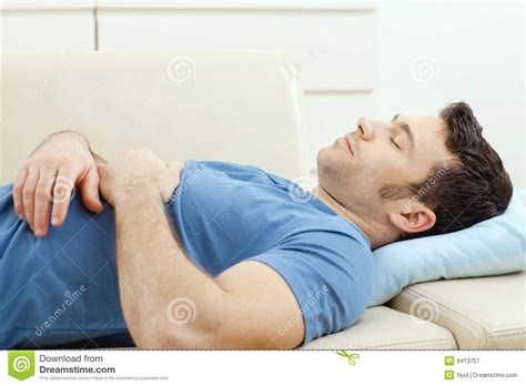 couch to sleep on man sleeping on couch royalty free stock photography