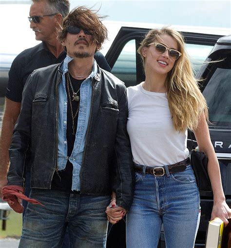 amber heard is apparently dating a rocket entrepreneur johnny depp s dogs could be put down in australia after
