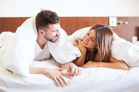 snuggling in bed cute couple snuggling in bed stock photo image of copy