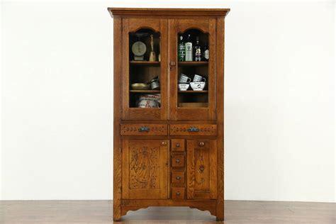 sold victorian eastlake  antique oak pantry cabinet