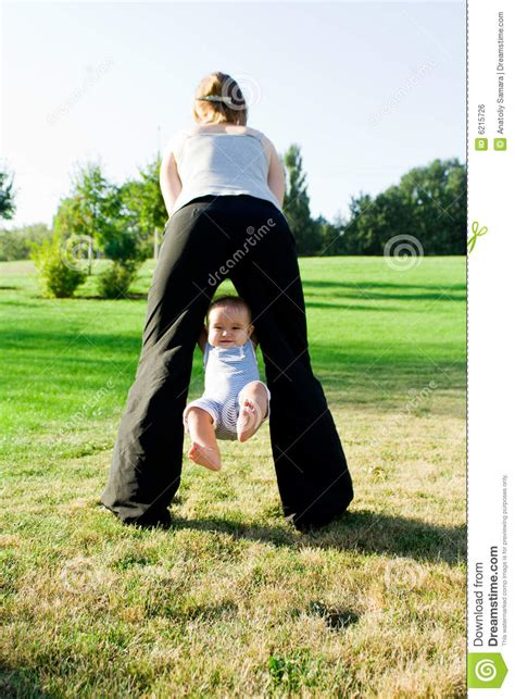 mom swinging baby mother swinging little baby royalty free stock image