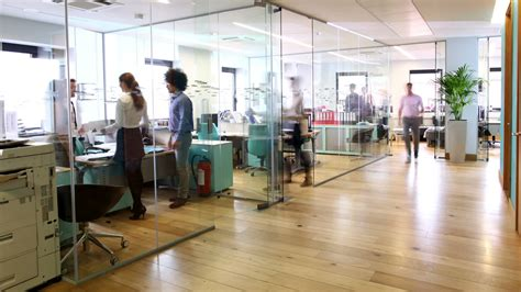In Office by Time Lapse Of Attractive Professionals At Work In