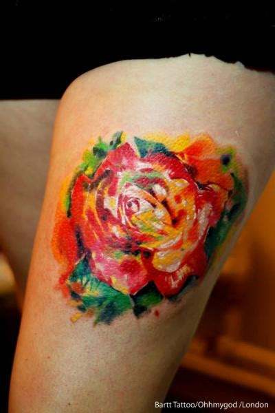 unique rose tattoo 2 unique orange on thigh