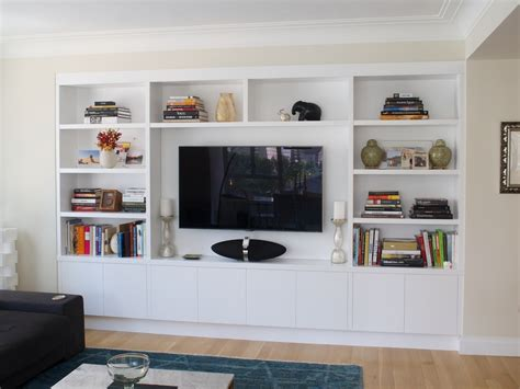 tv built in joinery configuration like this to take up tv wall and