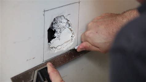 fix hole in wall how to repair drywall large hole build com youtube