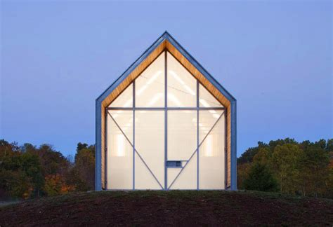 the shed by hufft projects glows like a lantern on a