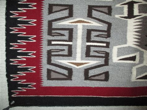 tug rug teec nos pos rug by renn smith larger size navajo weaving two grey