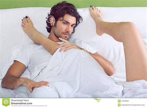 men and women in bed handsome man and woman legs stock image image 47926629