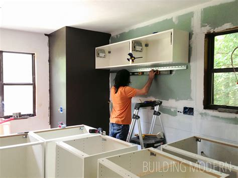 installing cabinets in kitchen ikea kitchen cabinet installation