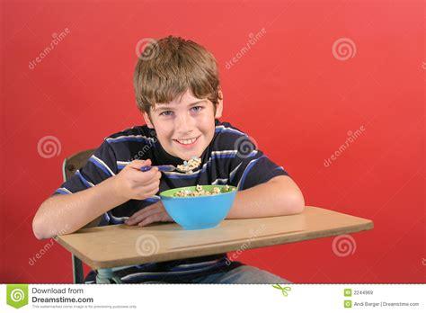 Kid At Desk Kid Cereal At Desk Royalty Free Stock Images