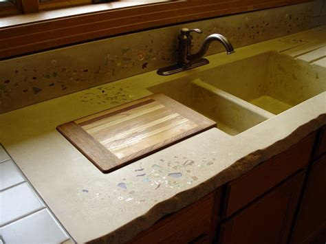built in cutting board yellow concrete counter with an integrated sink