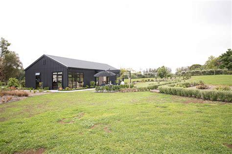 black barn beautifully landscaped shed homes barn