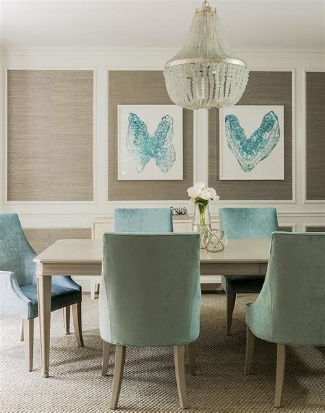 taupe and turquoise blue dining room features stacked