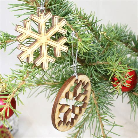 Laser Decorations - 12 laser cut snowflake decorations by cleancut