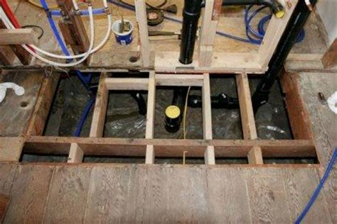bathroom floor joists trimming the joists to create a lowered floor how to