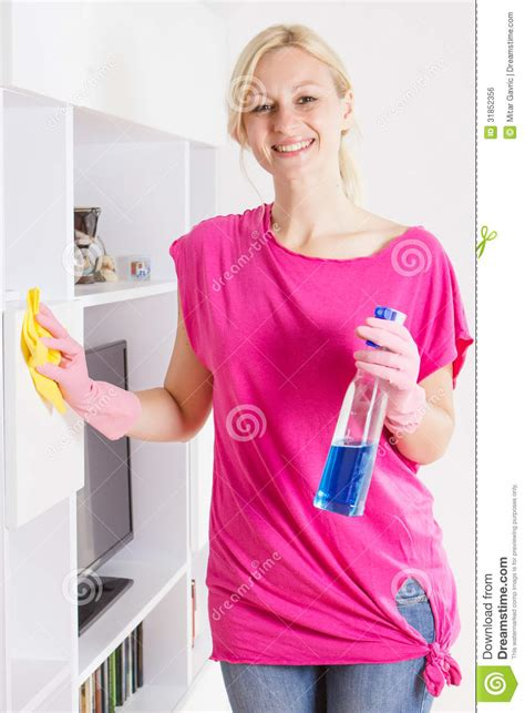 happy cleaning furniture at home royalty free
