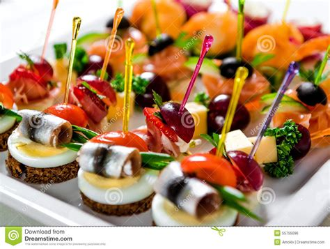 m and s canapes plate with various seafood and canapes stock photo