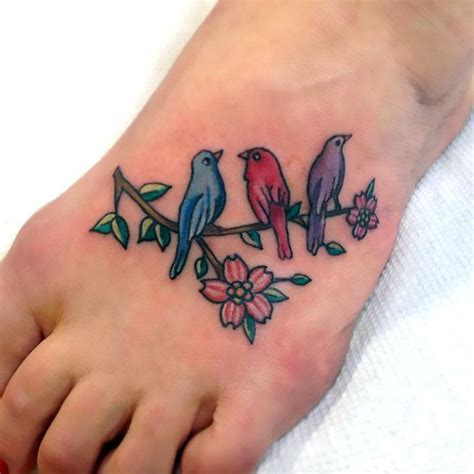 birds on foot tattoo idea