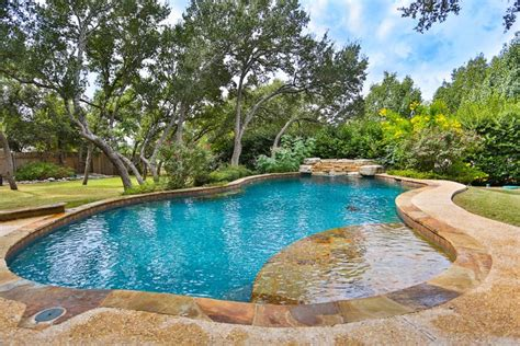 rustic swimming pool with fence exterior stone floors in boerne tx zillow digs