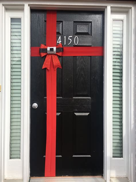 red christmas bow front door wrapping decoration front