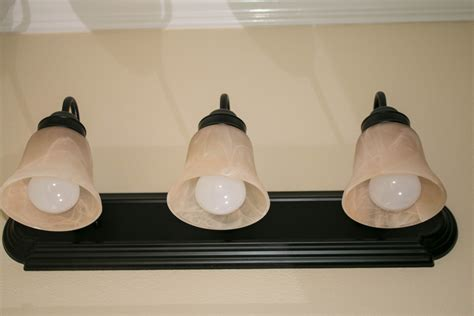 off center bathroom light fixture redo bathroom light fixture brightpulse us