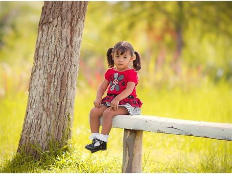 girl sitting on bench sad little girl sitting on bench hd wallpaper free desktop backgrounds and wallpapers