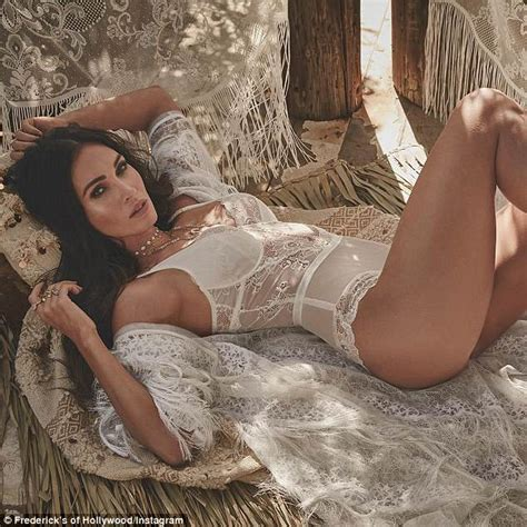 lorena sizzles as she poses on the bed wearing a hot black megan fox sizzles in white lingerie as she talks pressures
