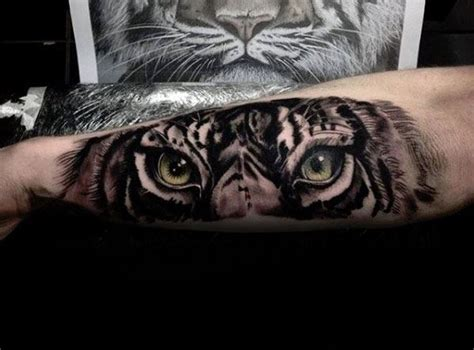 tiger eyes tattoo designs grey ink realistic tiger on forearm