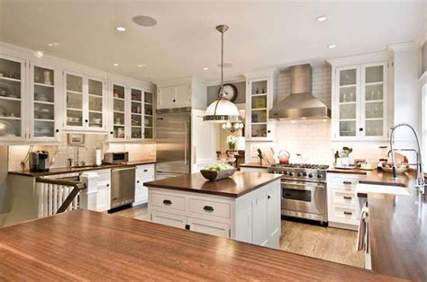 white kitchen bronze hardware gourmet kitchen transitional kitchen william a