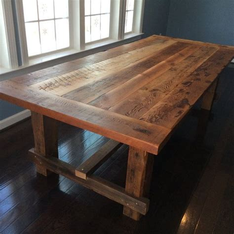 farm style dining table made from reclaimed barn