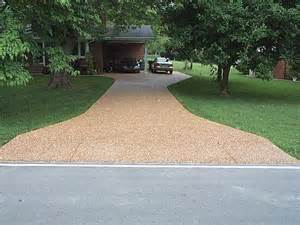 pea gravel embedded into concrete driveway