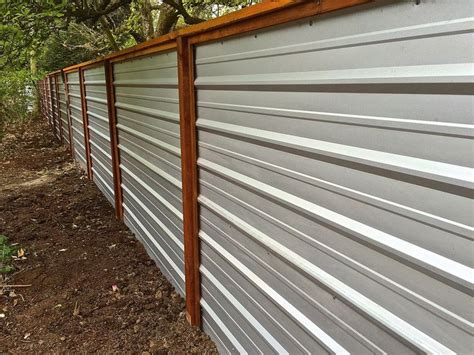 a galvanized corrugated metal fence creates a clean