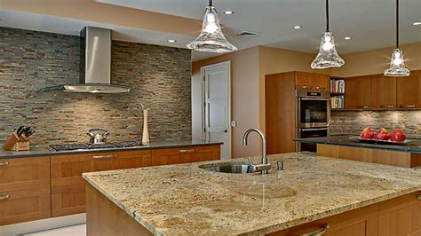 Granite counter samples, light maple kitchen cabinets