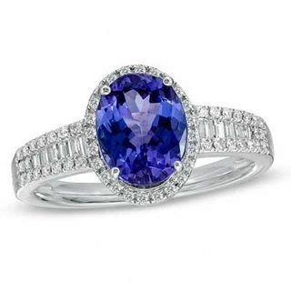 oval tanzanite and 1 3 ct t w ring in 14k white