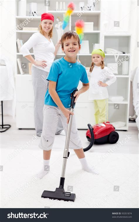 clean up day kids helping their mom doing chores stock