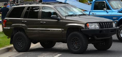 2001 jeep grand water install 2 inch spacers on a jeep grand wj 1999