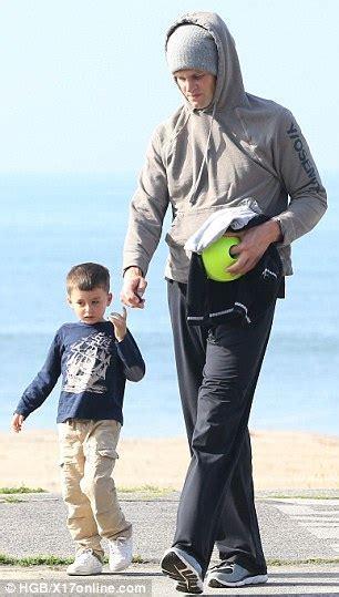 Tom Brady gives son Benjamin a piggyback ride on Santa