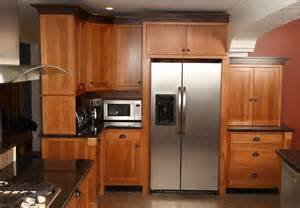 crafted craftsman style kitchen in cherry with black
