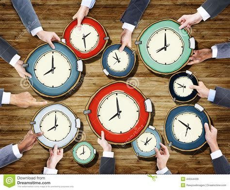 group  business peoples hands holding clocks stock