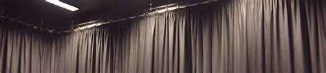 theatrical curtain track specialist installation of school hall stage curtains and