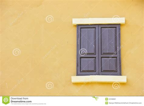 colors close to yellow close the window background color to a yellow wall stock