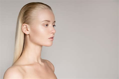 womans face at angle hair slicked on white stock photo tools for slicked back hair lionesse beauty bar