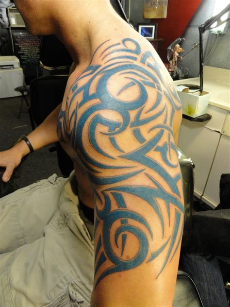 tribal tattoos on back for guys design and arts and design ideas