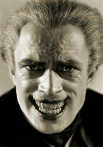 Grin was achieved by drawing back the corners of his mouth with hooks